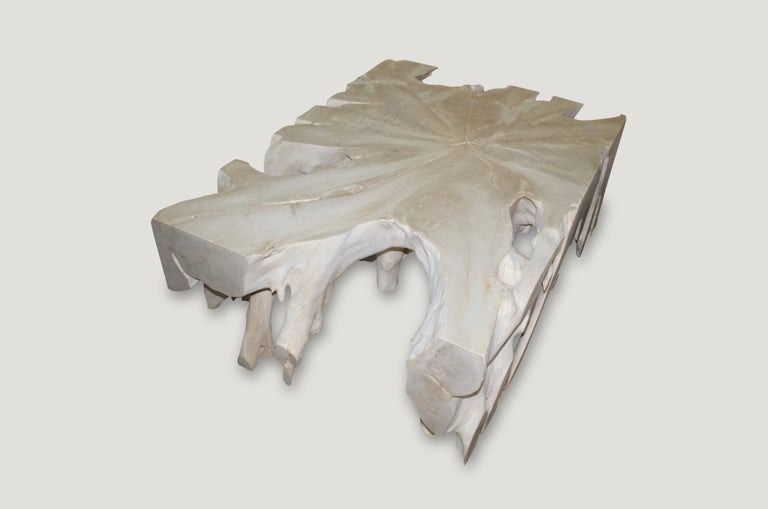 Impressive over sized teak root coffee table. Hand carved from a single reclaimed teak root. We have added a light shellack to the top and flat side sections for a contrast and for added protection. We can also Charr this black if preferred. Please