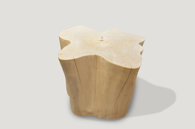 Reclaimed bleached teak wood amorphous side table. A slight graduation from the bottom to the top.   The St. Barts collection features an exciting new line of organic white wash and natural weathered teak furniture. The reclaimed teak is left to