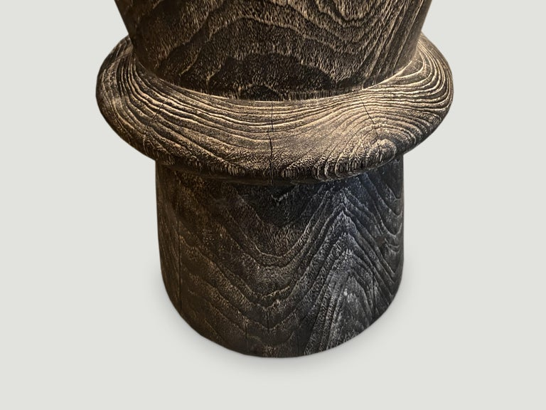 Hand carved side table made from reclaimed teak wood that we have charred one time and added a cerused finish. We have a collection. The price and size reflects the one shown.  Andrianna Shamaris. The Leader In Modern Organic Design.
