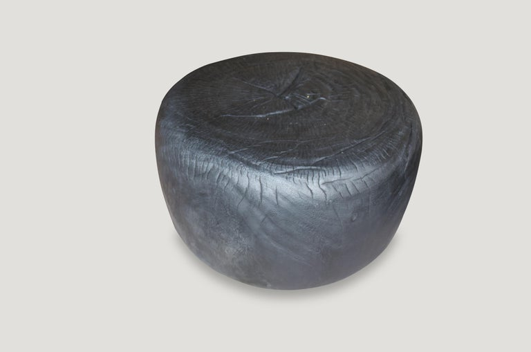 """Hand carved from a single suar wood root, a beautiful drum shaped coffee table. The top is 24"""" diameter and the outer sides expand to 26"""" diameter. We have a pair. The price reflects the one shown.  The Triple Burnt collection represents a unique"""