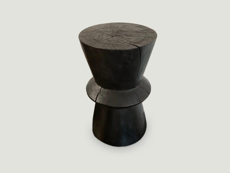 Hand carved side table made from reclaimed tamarind wood that celebrates cracks and crevices.