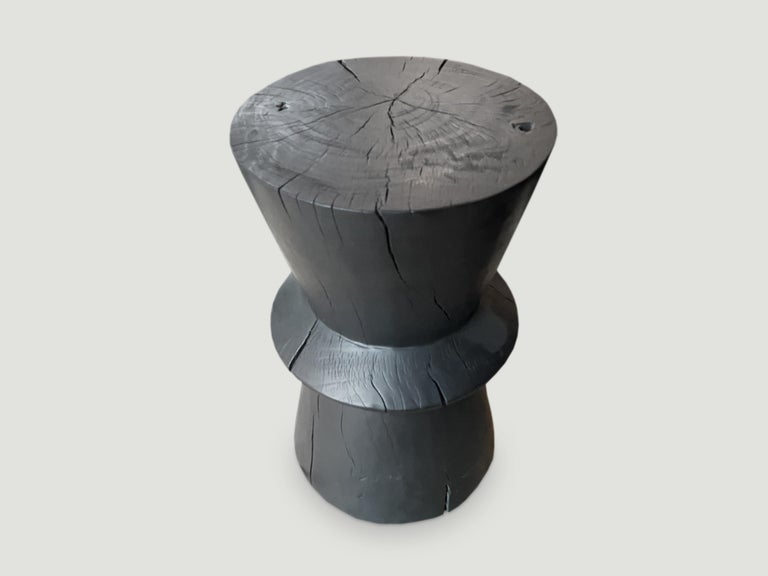 Hand carved side table that celebrates cracks and crevices found in reclaimed tamarind wood. We have a collection. The price and size reflect the one shown.  The Triple Burnt collection represents a unique line of modern furniture made from solid