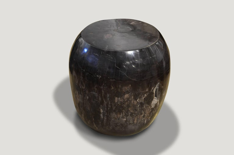 Super smooth petrified wood drum shape side table.  We source the highest quality petrified wood available. Each piece is hand selected and highly polished with minimal cracks. Petrified wood is extremely versatile – even great inside a bathroom