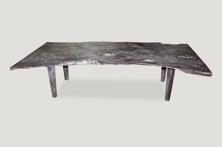 Reclaimed teak wood single two inch live edge coffee table or bench. We added the modern legs, charred the slab and added the cerused finish. Organic is the new modern.  Measures: 67 x 32- 24