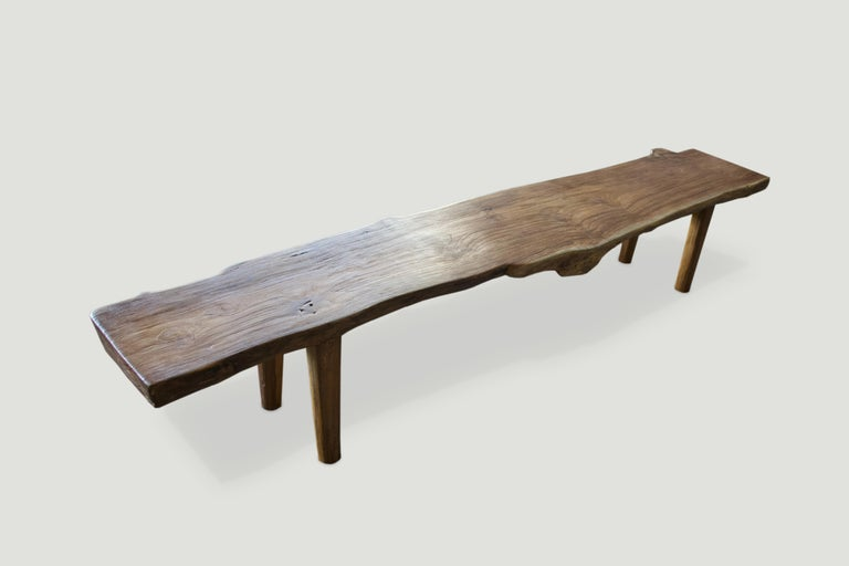 Impressive live edge reclaimed teak bench. Stunning grain in this single three inch thick slab with a natural oil finish. We added the midcentury style legs and can also increase the height for a console. Please inquire. Perfect for inside or out