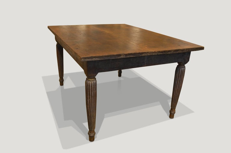 Antique teak wood dining table with a hand-carved bevelled edge and hand-carved legs with beautiful patina. Perfect as a dining table, entrance table or desk.  This table was sourced in the spirit of wabi-sabi a Japanese philosophy that beauty can
