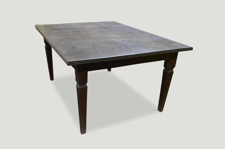 Stunning, rare, antique teak wood dining table with a hand carved bevelled edge and hand carved legs with beautiful patina.   This table was sourced in the spirit of wabi-sabi a Japanese philosophy that beauty can be found in imperfection and