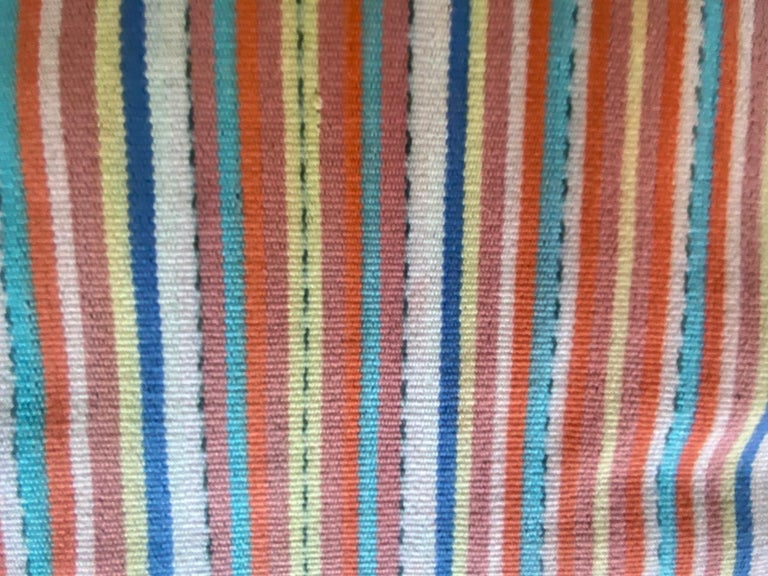 Stunning colors in this hand-woven textile from the island of Sumba, eastern Indonesia. The stripes seem modern yet mixed with the traditional center panel work so well together. Ikat is an ancient technique which is used to add patterns to