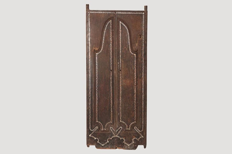 Andrianna Shamaris temple doors in teak wood. We added the shell inlay by hand for that special finish. Great as a headboard or accent piece. Can also be used as a tabletop.