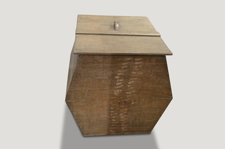 An unusual shaped wabi box originally used to store rice. Beautiful patina on an old teak wood piece.  This box was sourced in the spirit of wabi-sabi, a Japanese philosophy that beauty can be found in imperfection and impermanence. It's a beauty