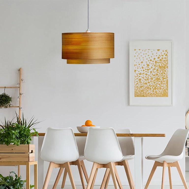 This large cypress wood drum light, ANDRO, is a Mid-Century Modern style pendant. Designers use a chandelier for alcove, entryway, dining room or conference room. ANDRO is a customizable shade offered in several wood types. ANDRO gives a warm light,