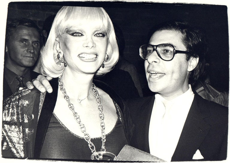 Andy Warhol, Photograph of Bob Colacello and a Woman, 1970s - Black Black and White Photograph by Andy Warhol