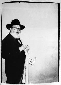 Andy Warhol, Photograph of Henry Geldzahler Lighting a Cigar circa 1981