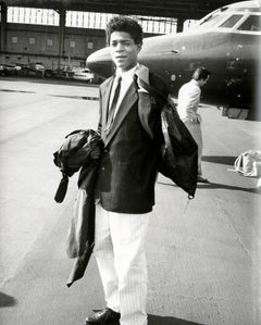 Andy Warhol, Photograph of Jean-Michel Basquiat Boarding a Private Jet, 1983