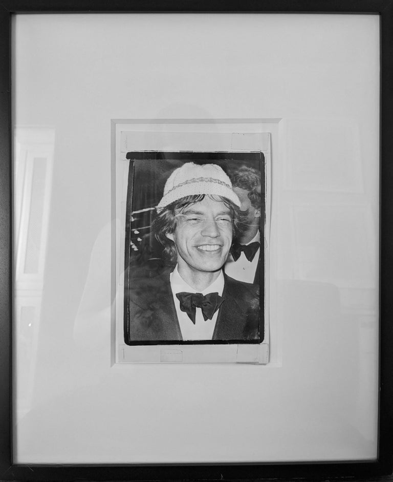 Mick Jagger in Hat - Brown Black and White Photograph by Andy Warhol
