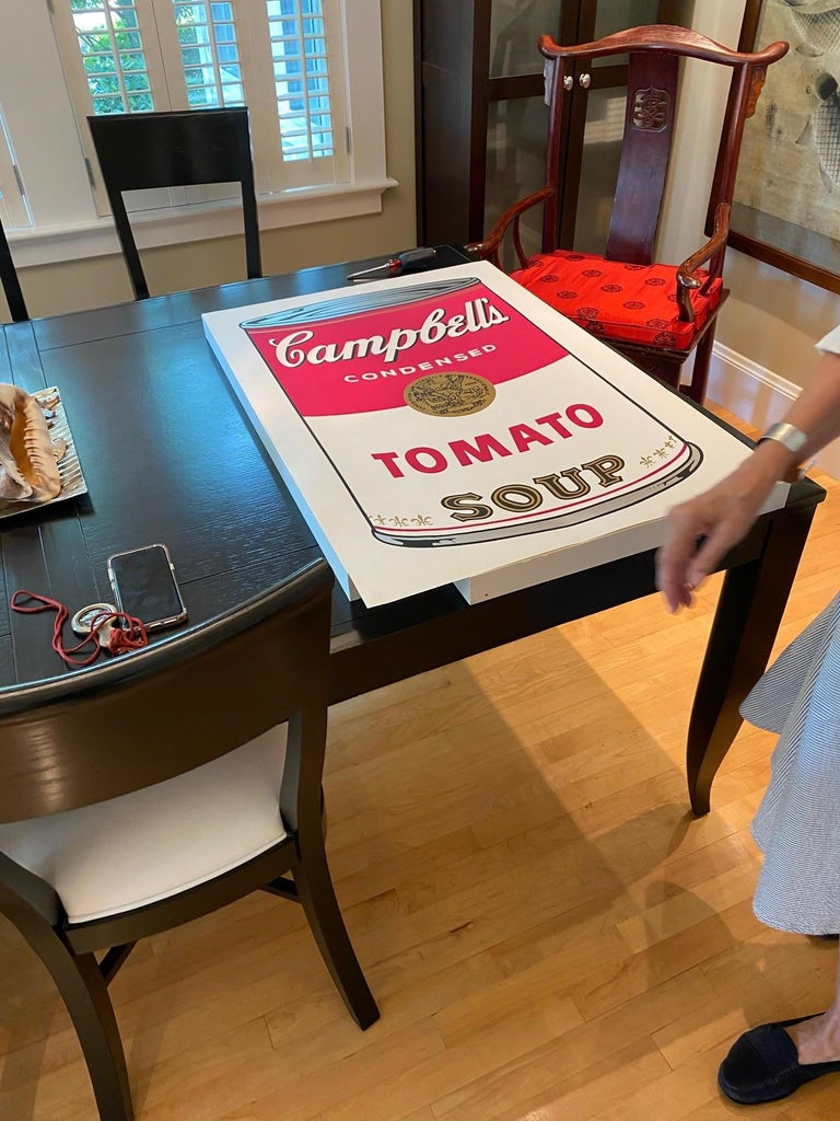 Hand signed by Andy Warhol in ball-point pen on the reverse. Numbered with a rubber stamp on the reverse. One of the most famous and recognizable images in art history, Andy Warhol's Campbell's Soup cans helped to usher in the Pop Art movement. This