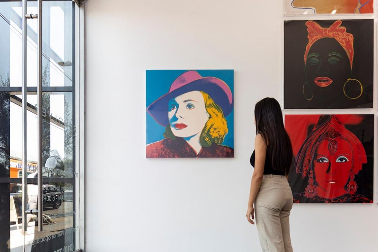 INGRID BERGMAN WITH HAT 315  The Ingrid Bergman series is made up of three types of screenprints of the Academy Award winning actress in 1983. The source images used for these portrait pieces include movie still from her role in the 1942 film