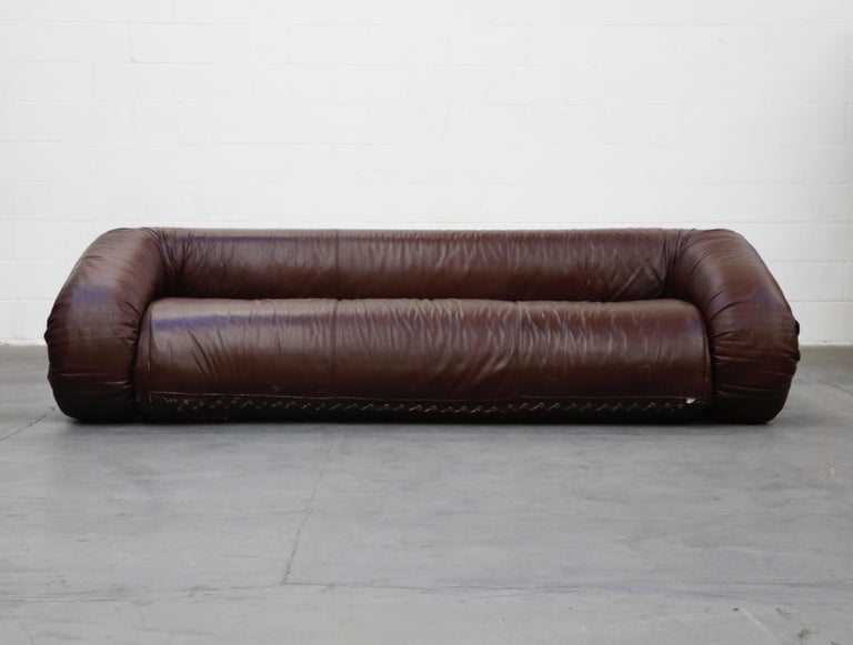 This incredibly coveted and sought after 'Anfibio' convertible sofa bed is by Alessandro Becchi for Giovanetti, designed and produced in the early 1970s, featuring incredibly luscious deep brown leather which has a slight warm tone that gives