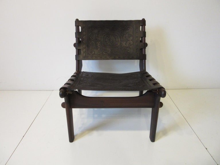A handcrafted lounge chair by famed designer and craftsman Ecuadoran Angel Pazmino made during the height of the 1960s Mid-Century Modern movement in South America. Made of solid rosewood using pegs and fitting together like an interlocking puzzle