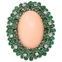 Angel Skin Coral Cocktail Ring with Emeralds and Diamonds, Circa 1970