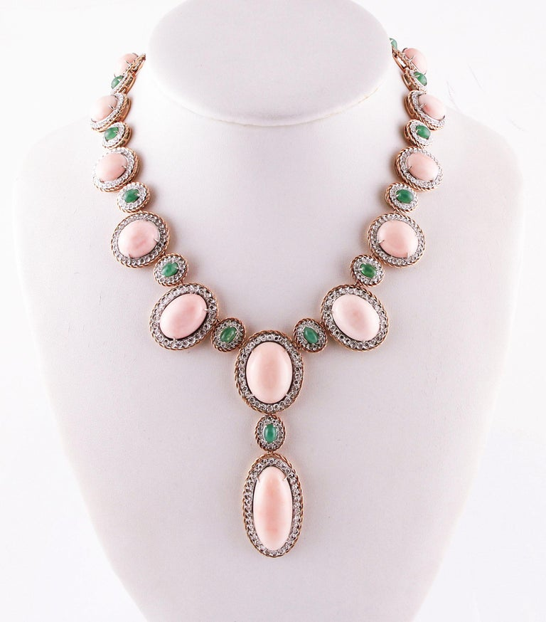 Unique necklace realized with special design in 14K rose gold and 14K white gold structure. The necklace is composed of 2 section: the first is realized with angel skin pink coral (secundum) surrounded by white diamonds and 14K rose gold crown; the
