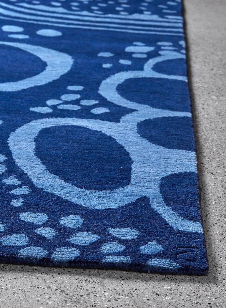 The Angela Adams glacier / blue area rug features a frozen landscape that celebrates the evolving and transformative quality of its namesake. At the same time energetic and calm, this design depicts once flowing rivers, round rocks, and circular air