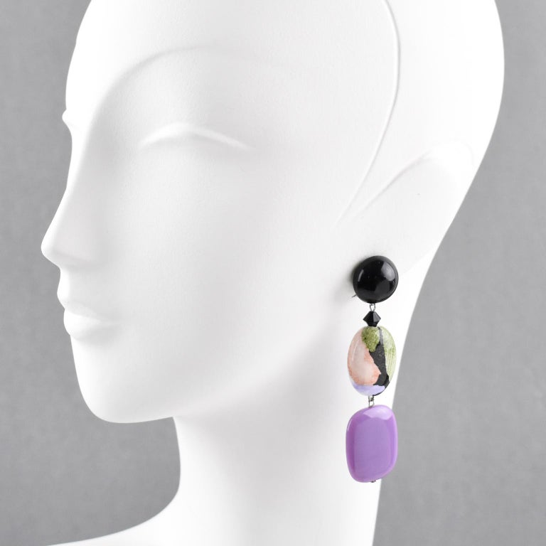 Romantic Angela Caputi, made in Italy resin clip-on earrings. Dangling shape with purple color pebble contrasted with a floral print olive bead. As you know Caputi jewelry is not signed, but this pair of earrings still has its original brand