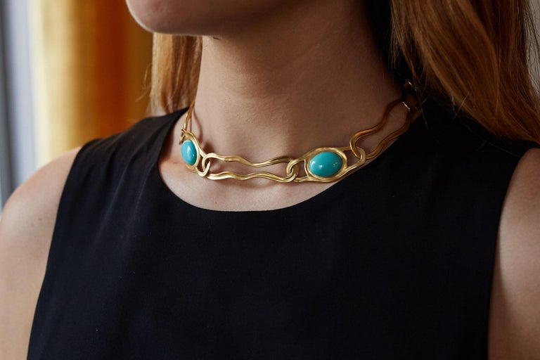 An 18 karat gold and cabochon turquoise large link necklace, by Angela Cummings for Tiffany & Co., 1982.  Signed Tiffany & Co. and Cummings. Stamped 18k and dated 1982.