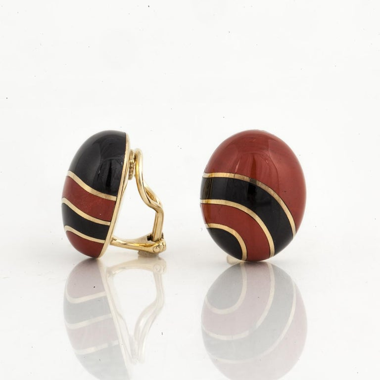 18K yellow gold earrings for Tiffany & Co. by Angela Cummings.  They are oval button style with inlaid jasper and onyx.  Each earring's design is opposite of the other one.  Measure 7/8