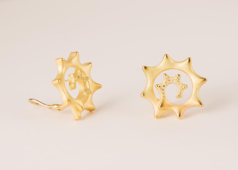Angela Cummings creates a playful pinwheel design and sprinkles it with a few brilliant cut diamonds. Approximately 1 inch in size.