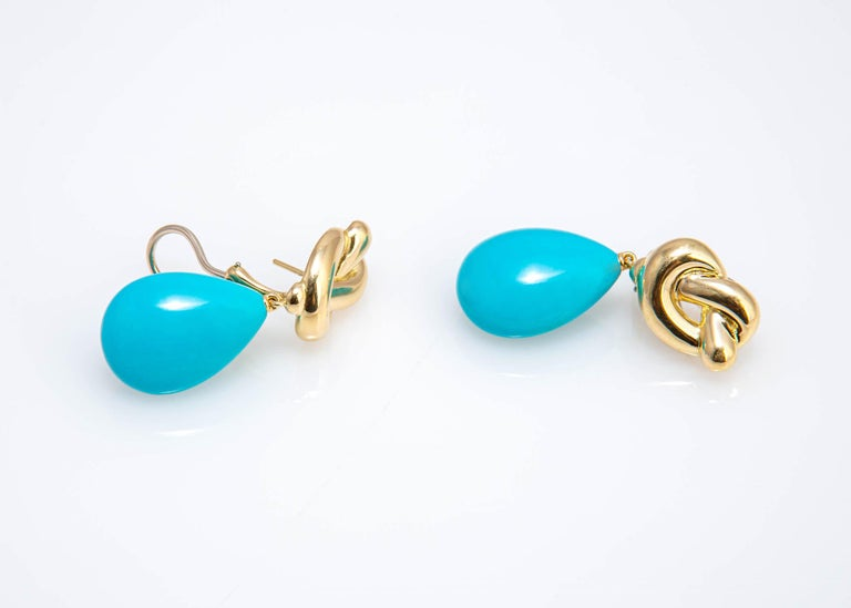 Angela Cummings began her career with Tiffany & Co. in 1968 and left to begin her own company in 1984. This pair of drop turquoise earrings is a great example of her attraction to colored stones. This earring was created in 1982 and is signed
