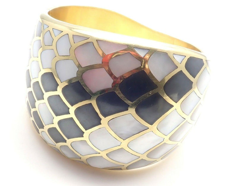 18k Yellow Gold Inlaid Mother Of Pearl Snakeskin Wide Bangle Bracelet by Angela Cummings.  Circa 1984. With inlaid mother of pearl to resemble snakeskin. Details:  Weight: 121.2 grams Length: 7