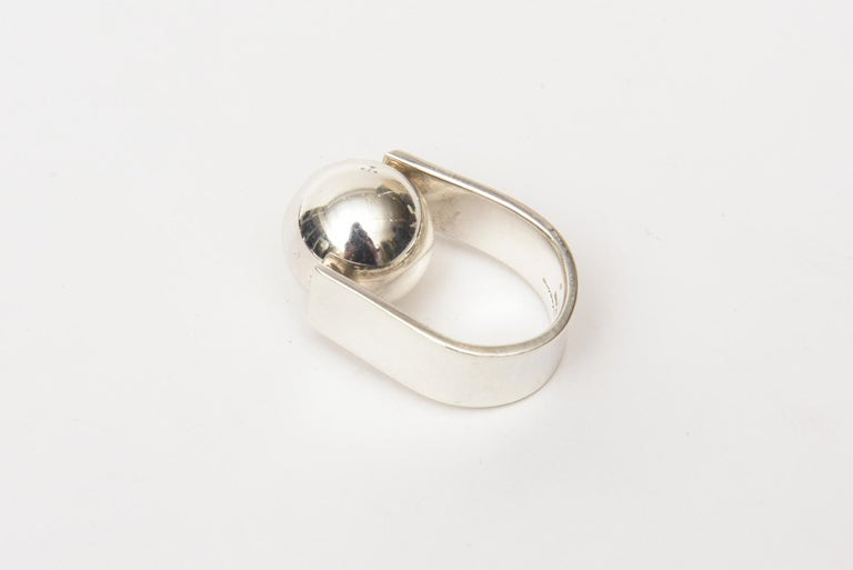 This very special sterling silver vintage hallmarked Angela Cummings ball ring is like a piece of sculpture on the finger. The ball moves. This is more on the rare side now. It fits a size 6 finger. Hallmarked. It is both modern and modernist. it