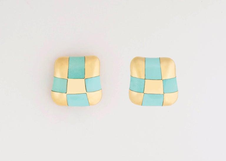 Angela Cummings began her career under the Tiffany & Co. umbrella before setting out on her own. Her designs featuring inlay stones in simple geometric patterns have become iconic and collectable.  This pair featuring turquoise is rarely available.