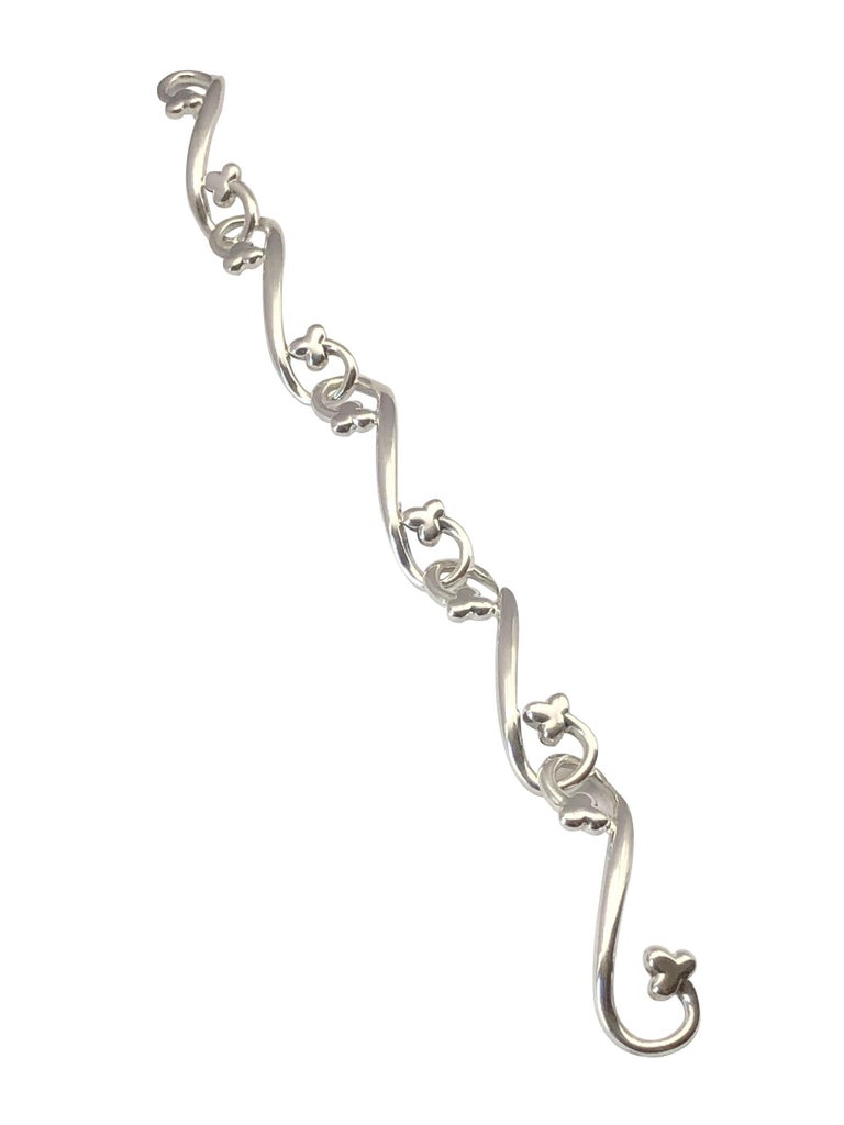 Circa 1987 Angela Cummings Sterling Silver Bracelet, comprised of long solid bar links curved at each end with a Clover, bracelet length 8 inches, this Cummings piece dates from just before her famous association with Tiffany & Company with many of