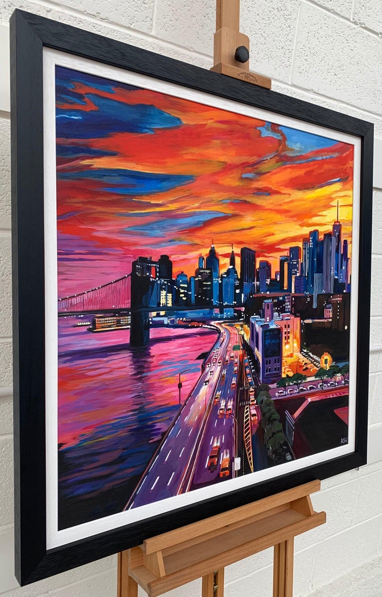 This painting captures the New York Skyline with Brooklyn Bridge set against the backdrop of a beautiful rich orange and red sunset from a high vantage point. The artist, Angela Wakefield, is a leading British Urban Cityscape Artist.   Art measures