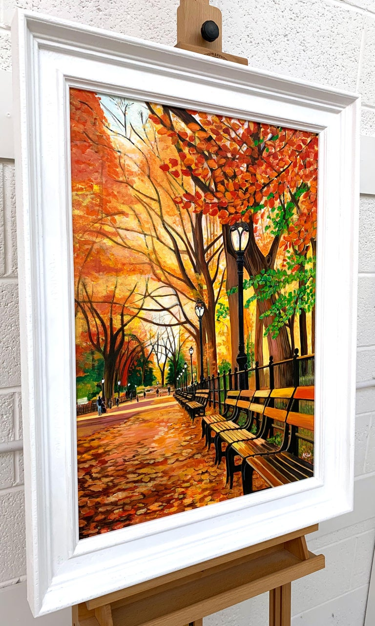 Contemporary Realism Painting of Central Park New York City in Autumn Fall by Collectible British Artist.  Art measures 20 x 28 inches Frame measures 26 x 34 inches  Angela Wakefield has twice been on the front cover of 'Art of England' and featured
