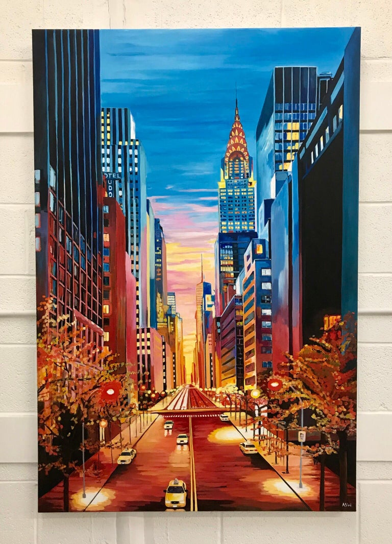This large painting is a striking, colourful and vibrant depiction of the Chrysler Building on 42nd Street in New York City with a dramatic sunset. The artist, Angela Wakefield, is a leading British Urban Cityscape Artist. Angela Wakefield has twice