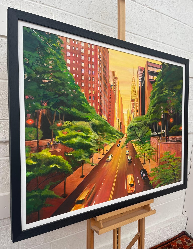 Original Painting of The Chrysler Building on 42nd Street New York City by Contemporary British Artist Angela Wakefield. The warm yellow colours used in the sky creates a vivid contrast with the lush greens in the foreground. The Manhattan