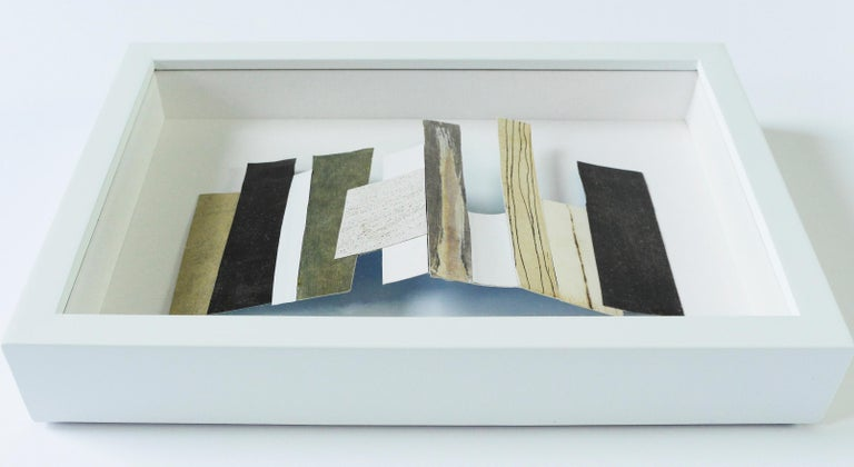 NY #3 2019 collage, recycled paper scraps (acrylic, etching print) 4.6 H x 3 W x 1 D in  11.6 x 7.6 x 2.54 cm – 8 1⁄4 x 6 3⁄4 x 1 3⁄4 in (framed) (Additional images of other NY   In honor of Earth Day and all things repurposed, Ground Floor Gallery