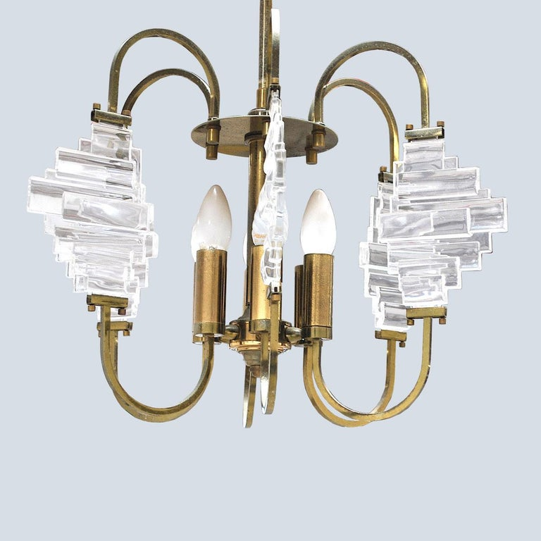 A suspension chandelier from the 1950s by Angelo Brotto.