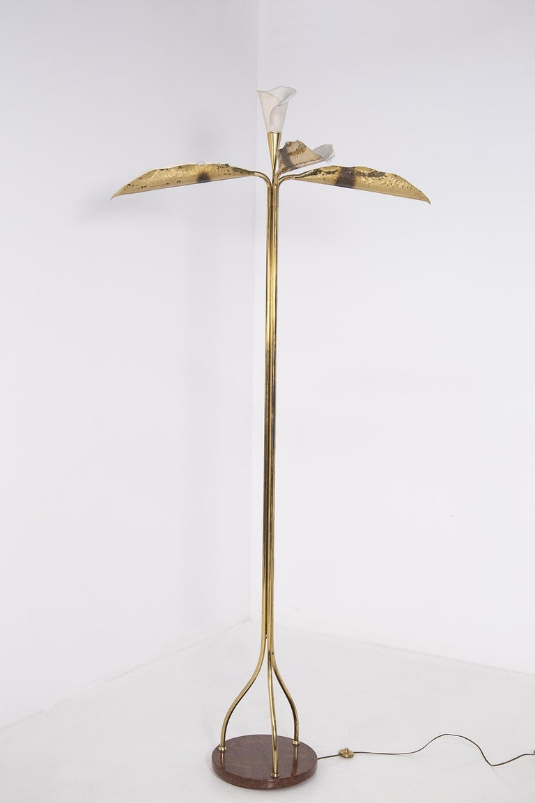 Elegant floor lamp by Angelo Lelii for the Arrodoluce manufactory in the 1950s. The lamp is made entirely of gilded brass and painted aluminum, composed of three
