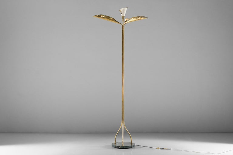 """Gilded brass and painted aluminum, composed of three out-turned and hammered """"leaves"""" beneath a stylized calla blossom, the grouped shaft separates in three near the refined marble base."""