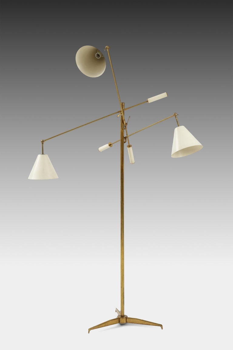 Designed by Angelo Lelii for Arredoluce iconic and original rare first edition Triennale model 2128 three-arm adjustable counter-balance floor lamp, Italy, circa 1951. Each original off-white painted shade is attached to pivoting arm which