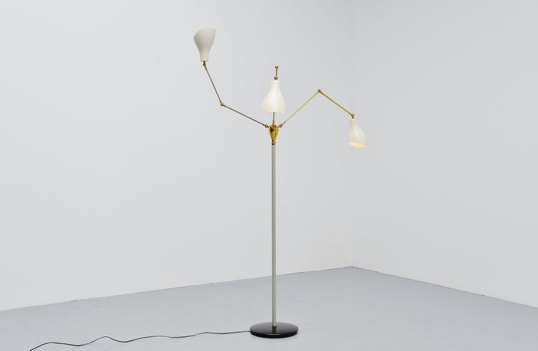 Fantastic three-armed adjustable standard lamp designed by Angelo-Lelli and manufactured by Arredoluce, Monza, Italy, 1950.This fantastic adjustable floor lamp is super nice large shaped and has three fully adjustable arms. This superb quality lamp