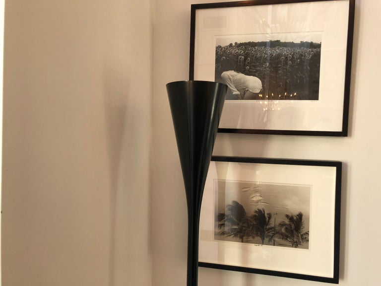 Beautiful sleek black enameled floor lamp/torchere designed by Angelo Lelli for Arredoluce. Has a white marble base and can accommodate either flood or spot light bulb. Made in Italy, circa 1960.