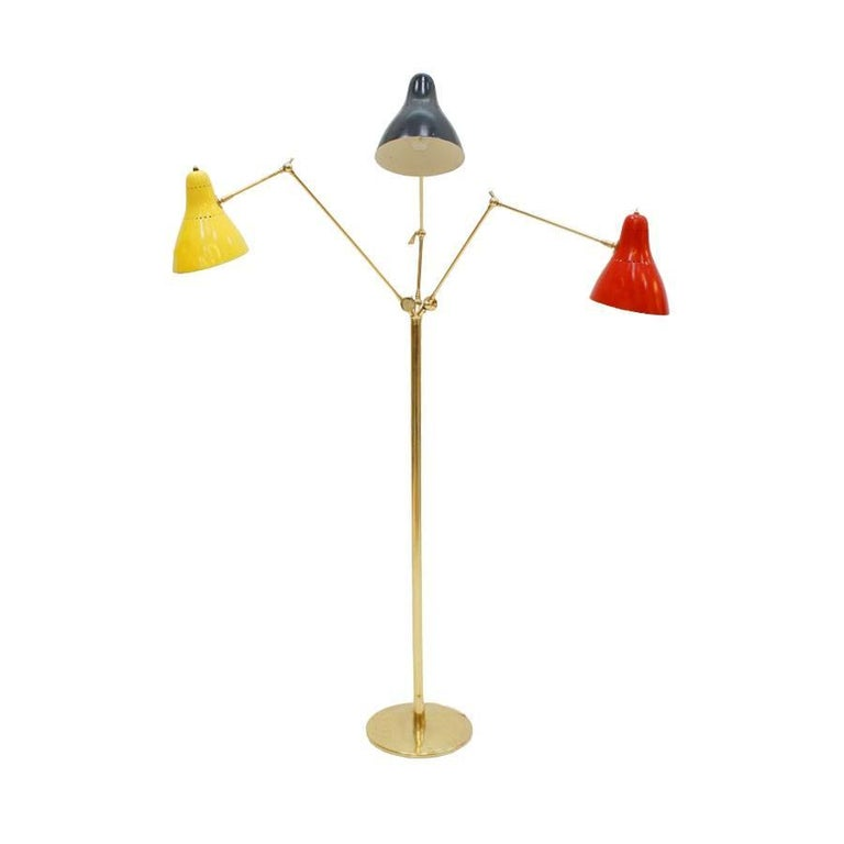 Italian floor lamp with three points of light designed by Angelo Lelli. Structure made of brass composed of three articulated arms with adjustable cups.  Our main target is customer satisfaction, so we include in the price for this item