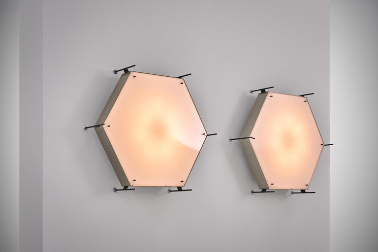 Rare and impressive pair of model no. 12712 lamps by Angelo Lelli for Arredoluce, Italy circa 1958. Very well made lamps out nickel-plated brass, painted brass and an acrylic diffuser. The lamps make quite an impression due to it's size and radical