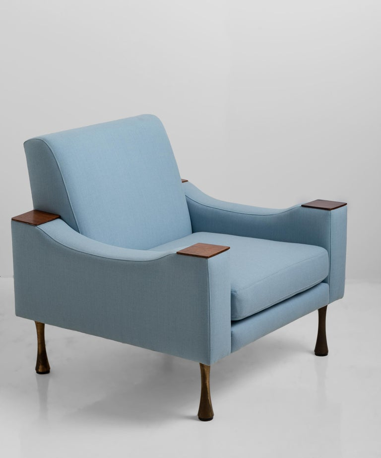 Angelo Mangiarotti armchair in wool blend from Maharam, Italy, circa 1960  Teak wood details with brass legs.