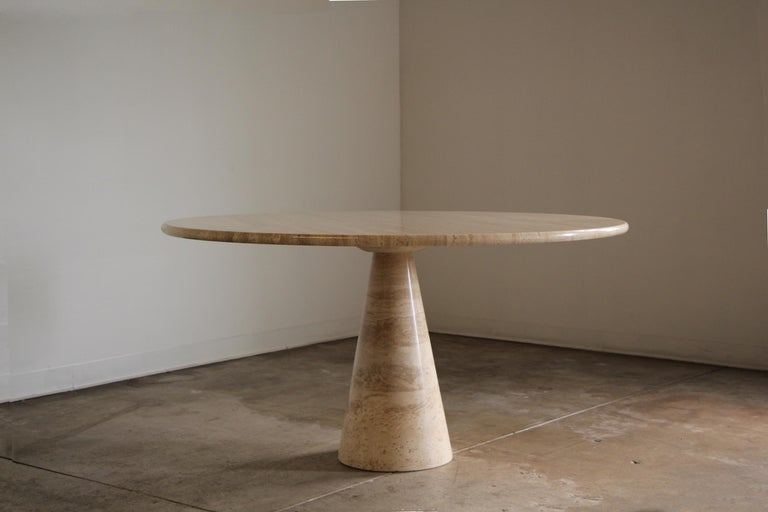 Such a stunning piece of functional art, this sculptural travertine dining table is attributed to Angelo Mangiarotti, circa 1970s, and is the much larger 55